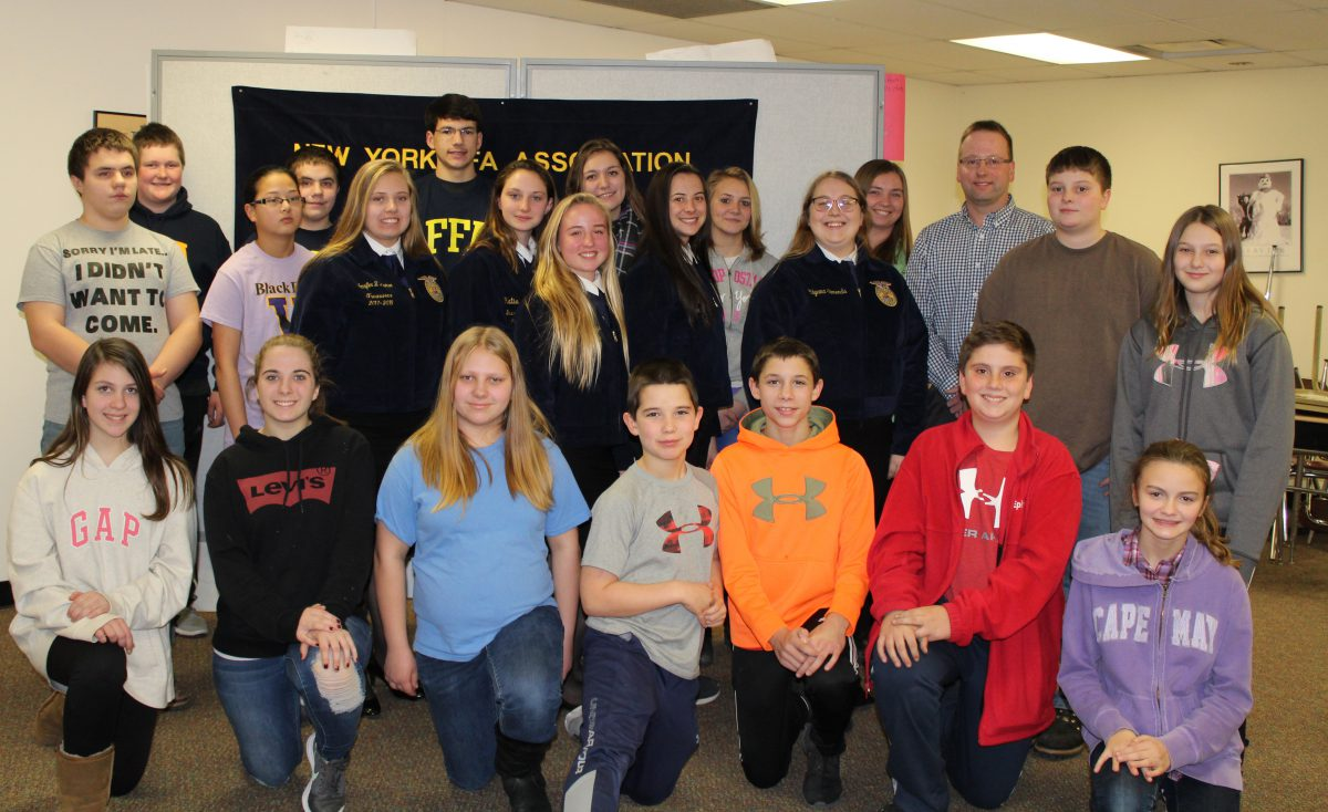group of FFA members and company branch manager in front of an FFA sign