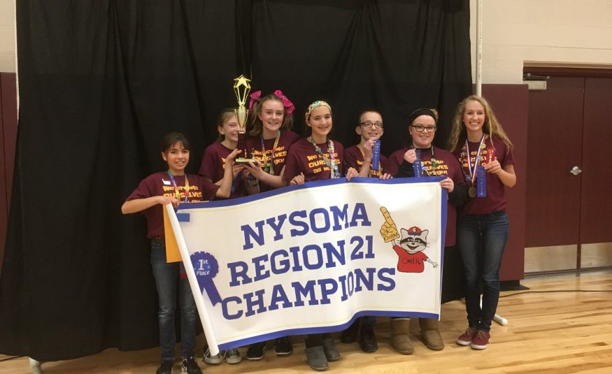 "students hold a trophy, a ""champions"" banner and blue ribbons"