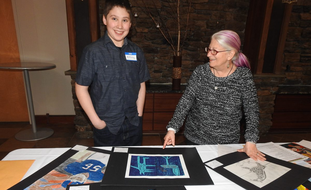 Art students' portfolios are rated by professional artists