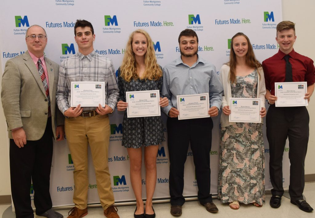 five Fonda-Fultonville high school students with FMCC administrator