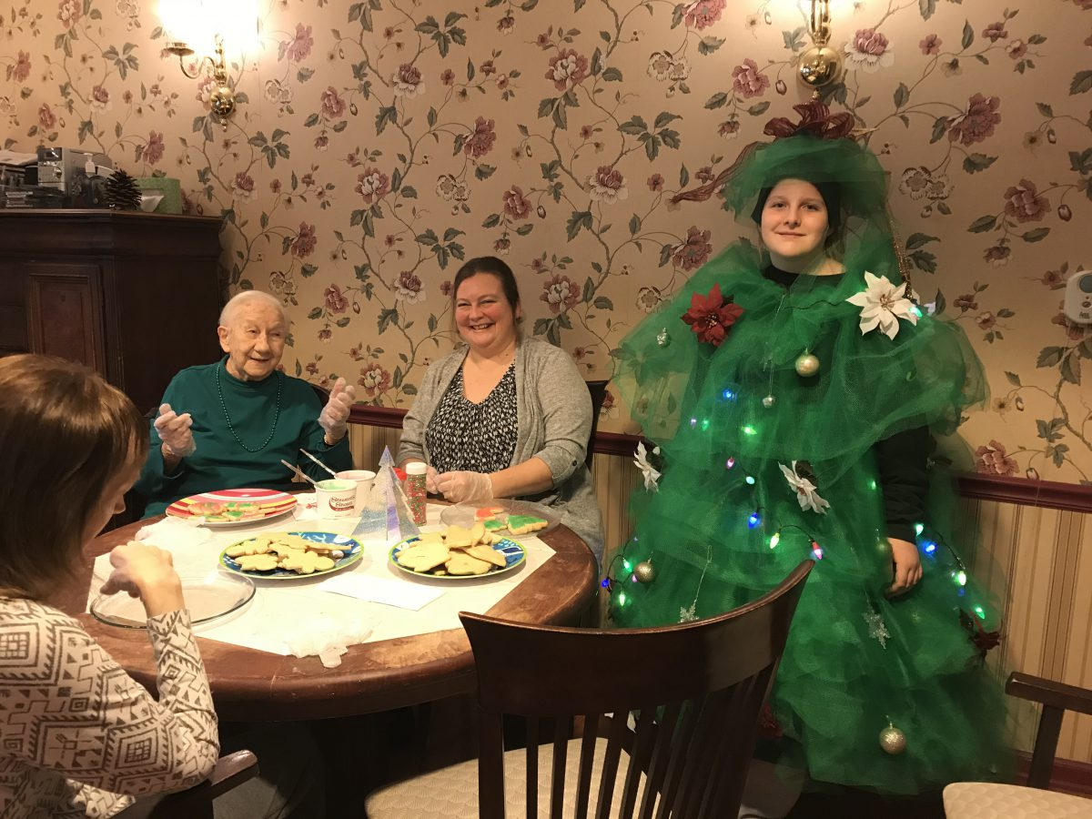 Character clubs spread holiday cheer at local nursing home
