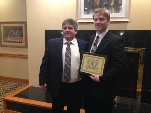 high school football coach with scholar athlete
