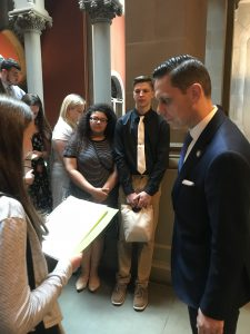 student reads question off a paper for state assemblyman