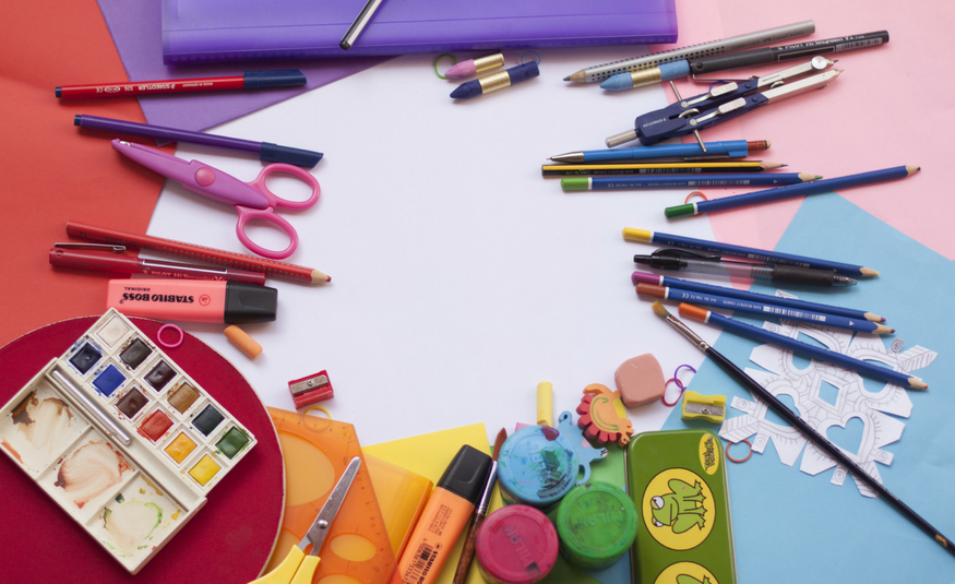 variety of school supplies arranged in a circular pattern