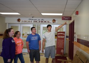 Four students stand in an entryway