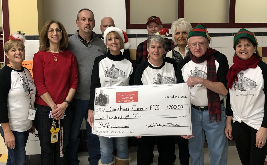 members of the community foundation hold a large check