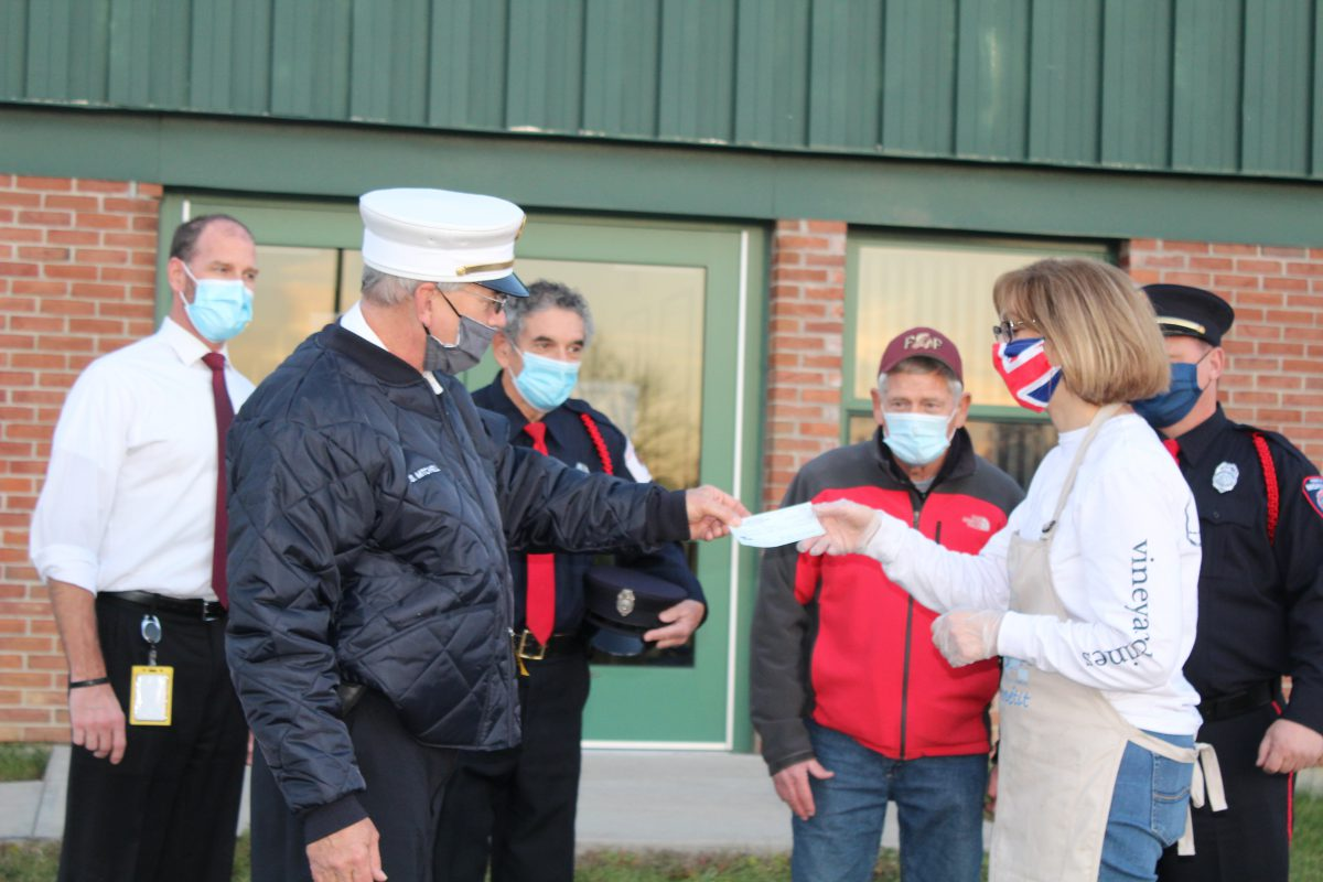 Fire department makes generous donation to Christmas Cheer